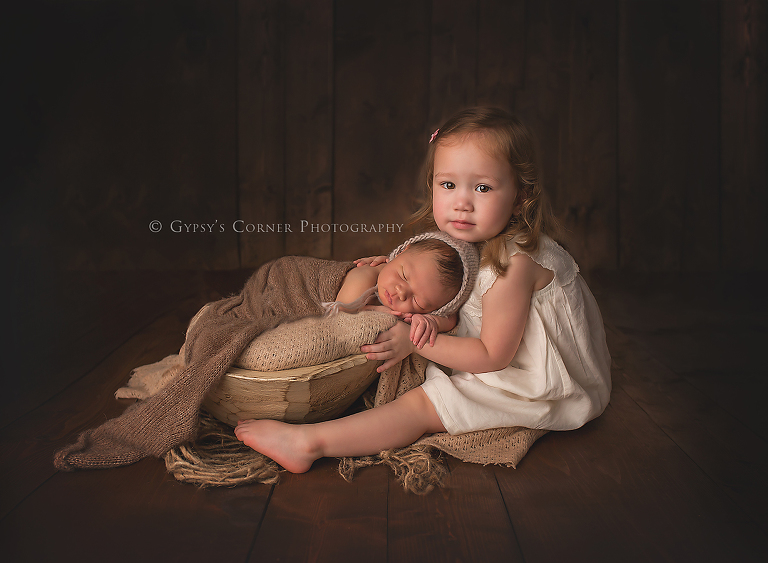 Newborn photography session big sister and newborn baby boy by gypsys corner photography